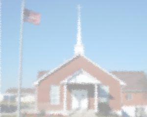 We see the church out of focus